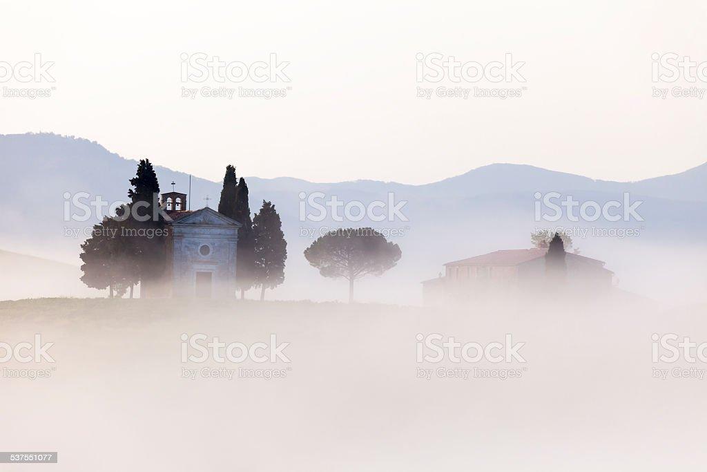Capella di Vitaleta, Morning Fog, Val d'Orcia, Tuscany, Italy stock photo