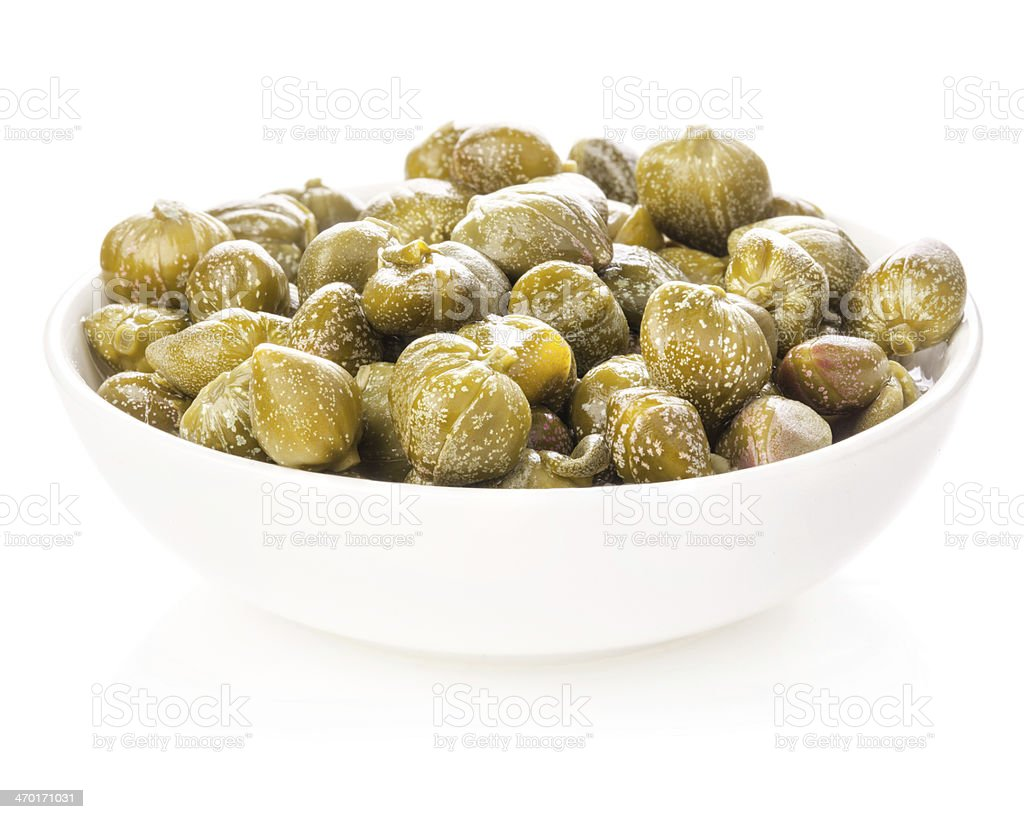 Capers in bowl stock photo