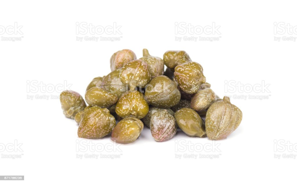 Capers isolated on white background. Pickled capers. Canned capers stock photo