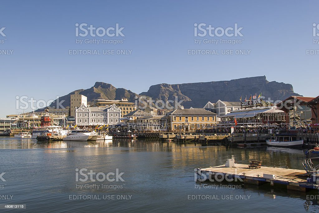 Capetown CapeTown, South Africa - December 21, 2008: Shops and restaurants at Cape Towns Waterfront. A popular area for tourists and locals. In the background a beautiful view of Table Mountain. Africa Stock Photo
