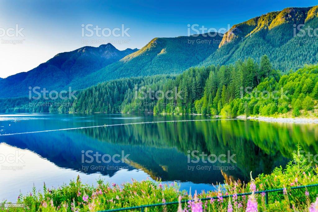 Capilano Reservoir Lake Green Mountains Vancouver British Columbia stock photo