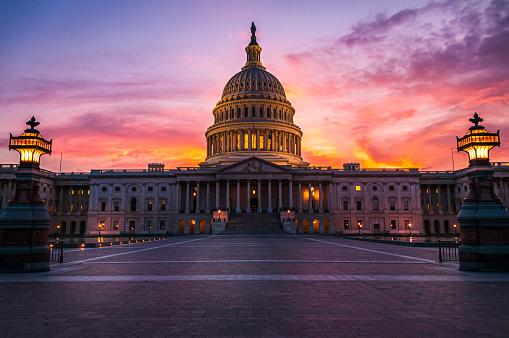 The capital dome illuminated after dark in Washington DC.