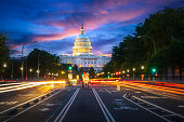 Capital building in Washington DC city at night wiht street and cityscape, USA, United states of Amarica