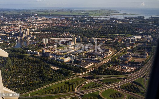 istock Capital City Amsterdam Aerial View from Jet Aircraft Porthole 504181454