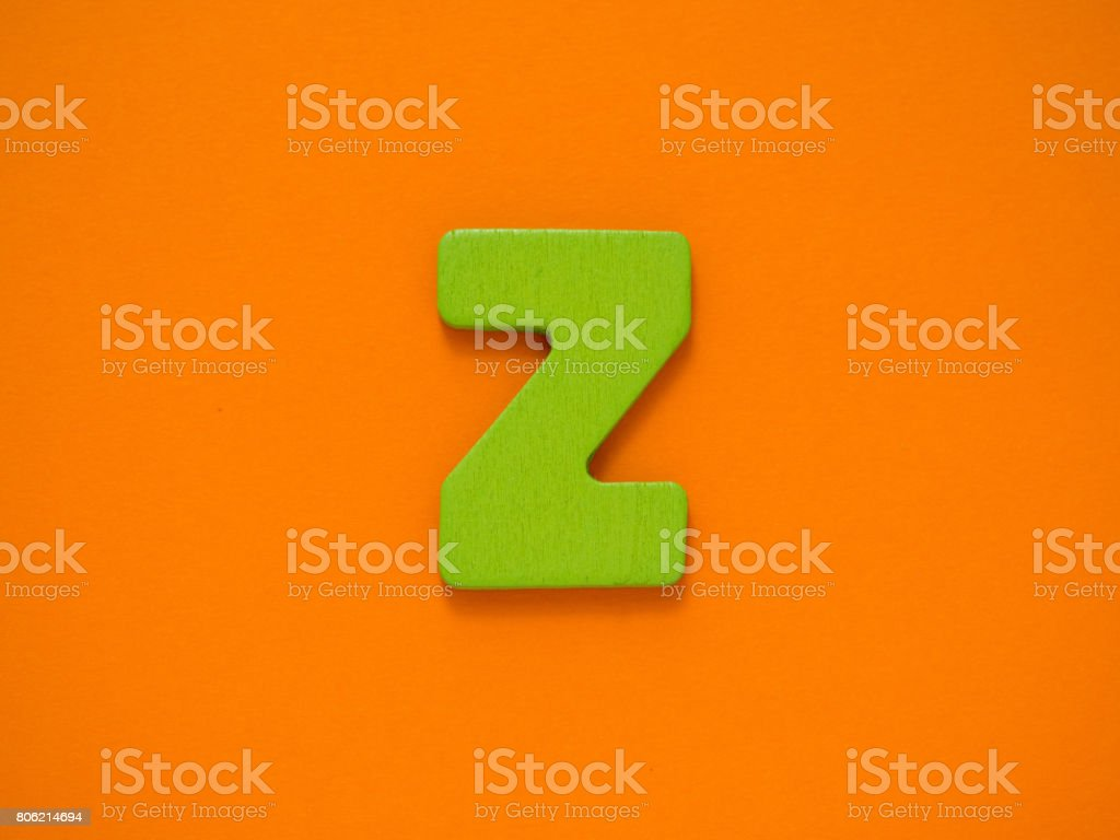 Capital letter Z. Green letter Z from wood on orange background. stock photo