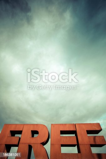 istock Capital letters FREE with cloudy sky 186381051