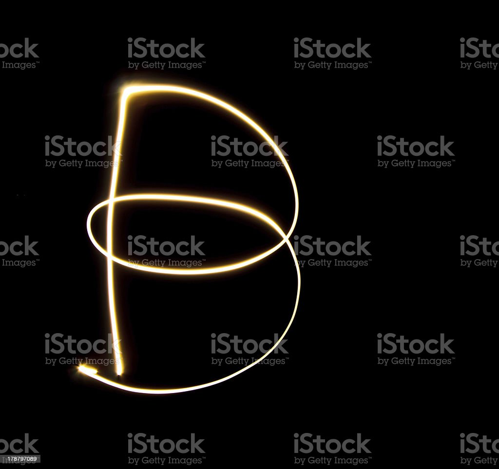 B capital light with black background royalty-free stock photo