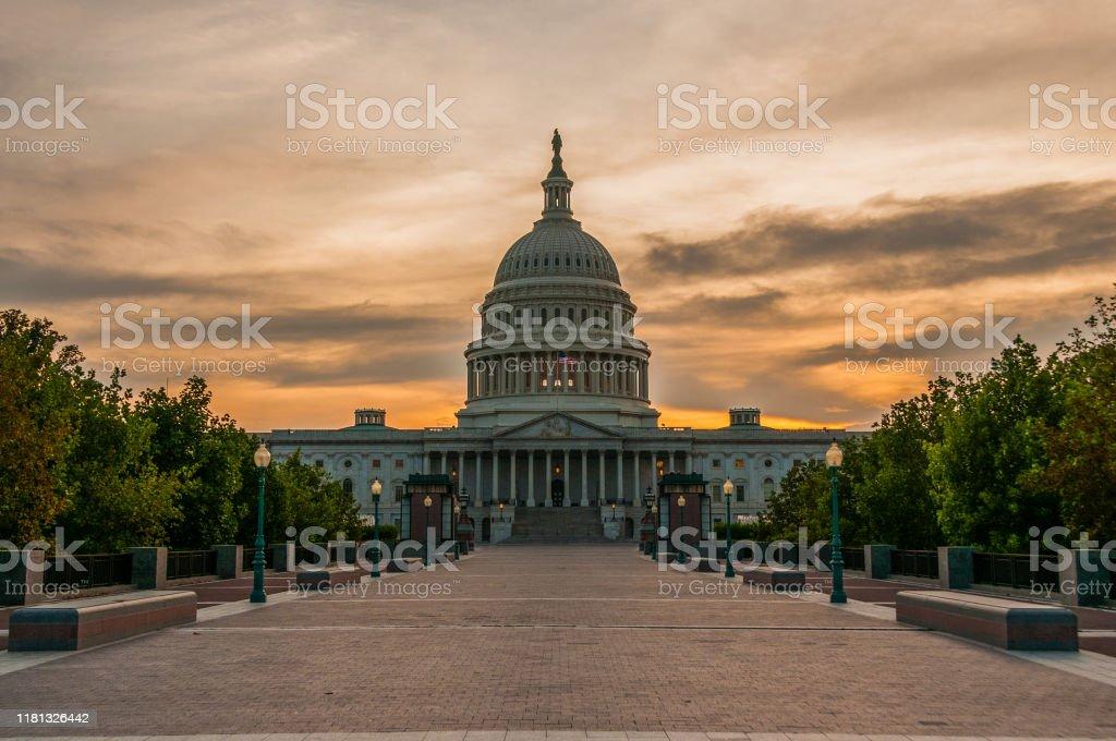 Capital Sunset The US Capital building at sunset. Cloud - Sky Stock Photo