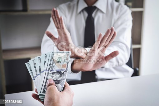 istock Capitalists give money, but officials refuse to accept bribes. Fraud, Illegal, Corrupt concept. 1078283480
