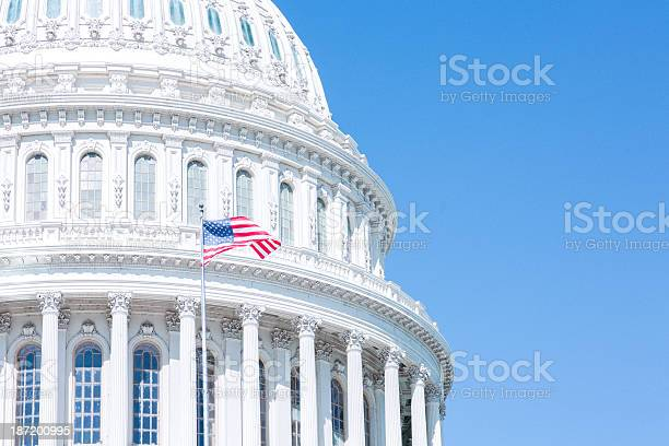 Capitol and flag in the blue sky picture id187200995?b=1&k=6&m=187200995&s=612x612&h=sw5vsogt5fz7hrpt  qz95apjlupn wdop7hzfeiu8u=