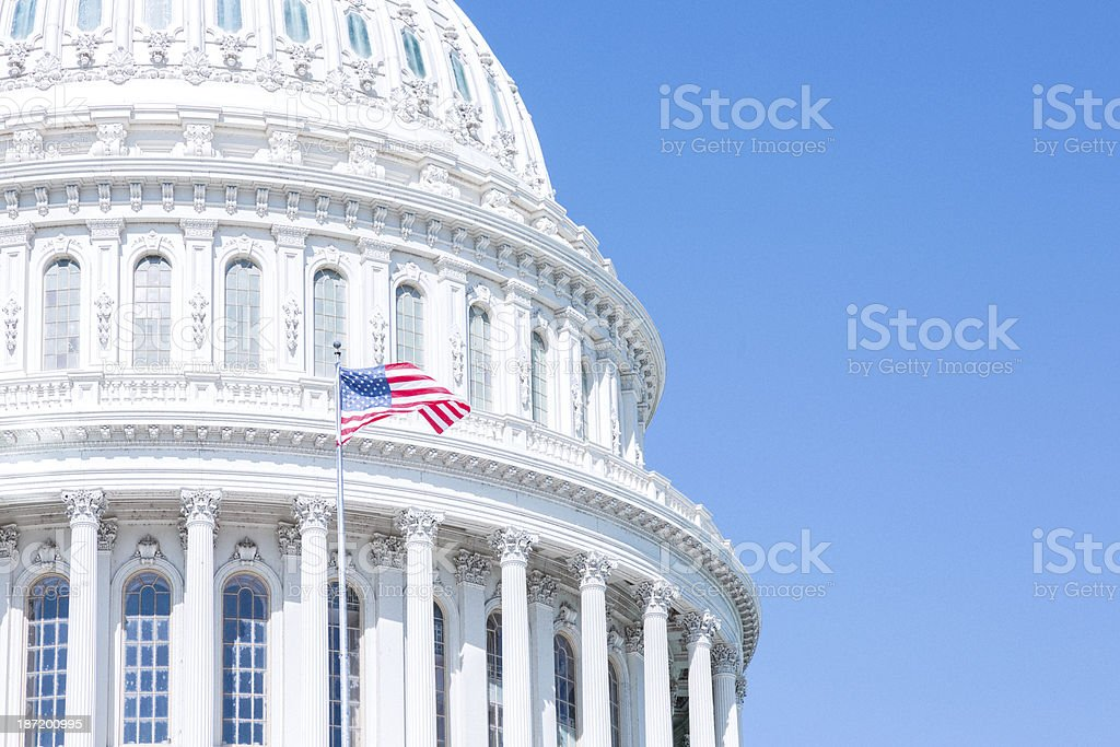 US Capitol and Flag in the Blue Sky stock photo