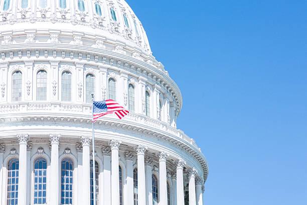 us capitol and flag in the blue sky - kubbe stok fotoğraflar ve resimler