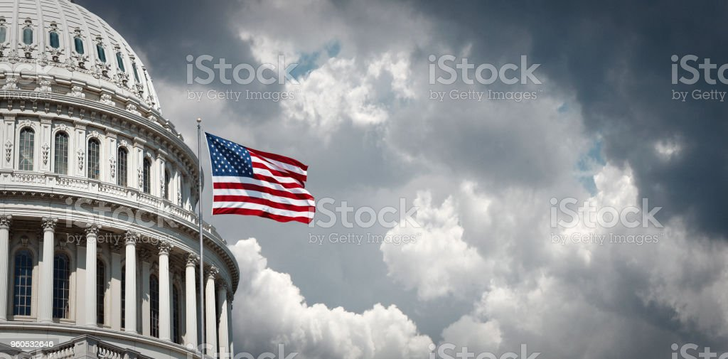 US Capitol and waving american flag Panoramic view of the United States Capitol and waving american flag in Washington DC American Culture Stock Photo