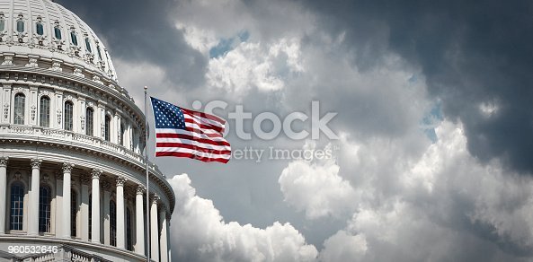 istock US Capitol and waving american flag 960532646
