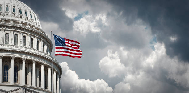US Capitol and waving american flag Panoramic view of the United States Capitol and waving american flag in Washington DC state capitol building stock pictures, royalty-free photos & images