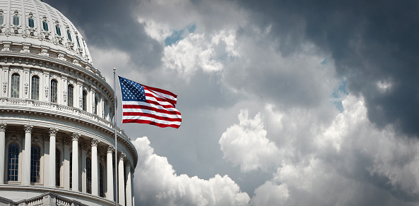 Us Capitol And Waving American Flag Stock Photo - Download Image Now