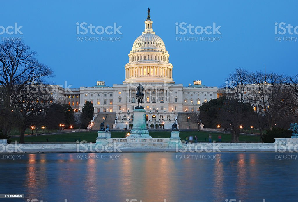 U.S. Capitol at night, and reflection in water royalty-free stock photo