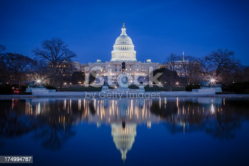 istock U.S. Capitol at night, with reflection on ice 174994787
