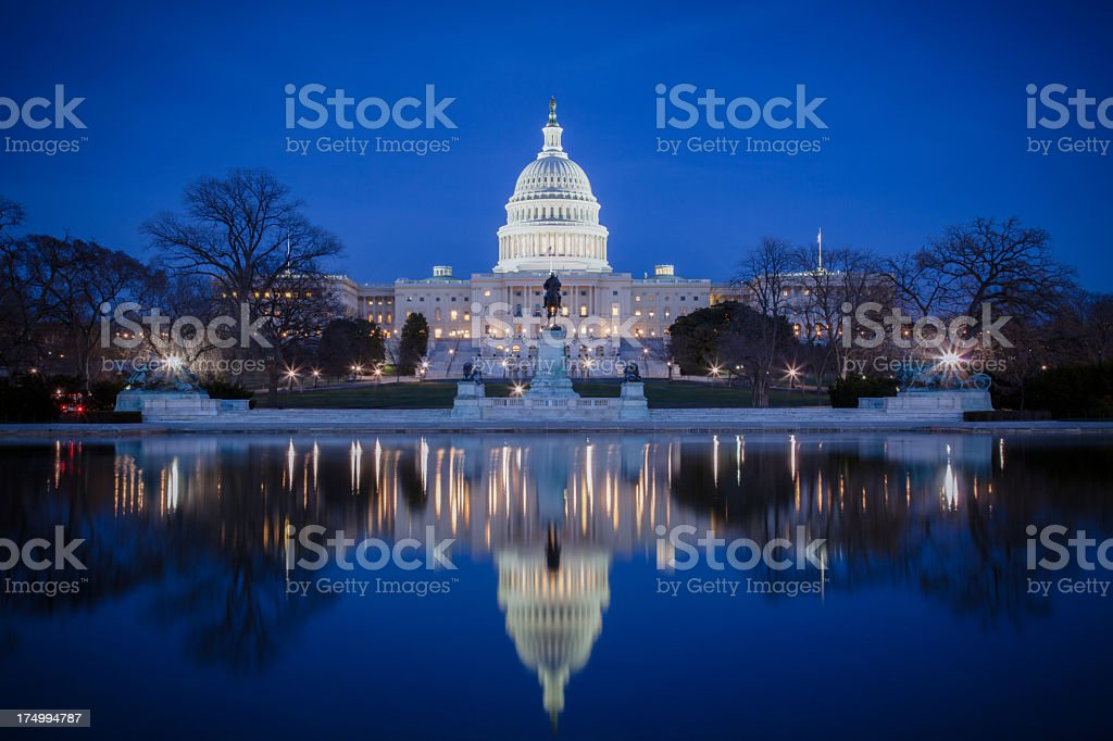 U.S. Capitol at night, with reflection on ice stock photo