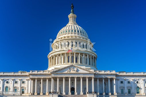 US Capitol over blue sky