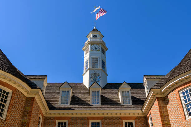 Capitol Building - A replica Grand Union Flag, the first national flag of USA, flying at top of bell tower of the Capitol Building in Williamsburg, Virginia, USA. stock photo