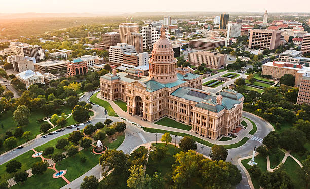 Capitol building, aerial skyline, sunset, Austin, TX,  Texas State Capital aerial view of Capitol building in Austin the Capital of Texas state capitol building stock pictures, royalty-free photos & images