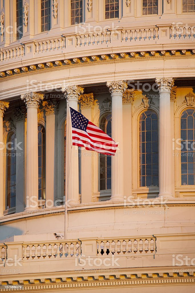 US Capitol Building and Flag at Sunset royalty-free stock photo