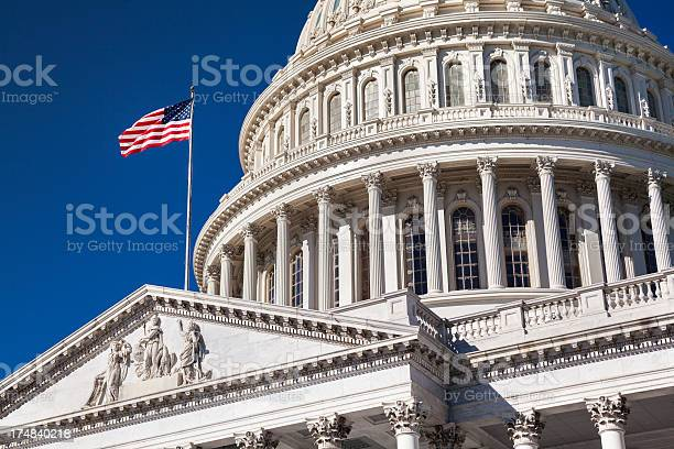 Capitol building and the american flag picture id174840218?b=1&k=6&m=174840218&s=612x612&h=zlyuveoubn8v7v4m731v4xfsqiwgqn4awiiqv8a9tgs=