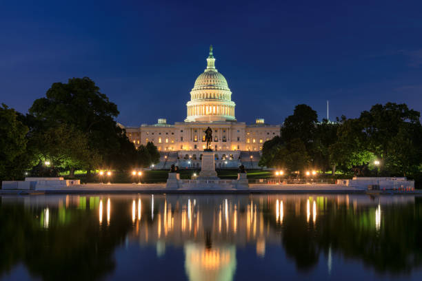 US Capitol Building at night stock photo