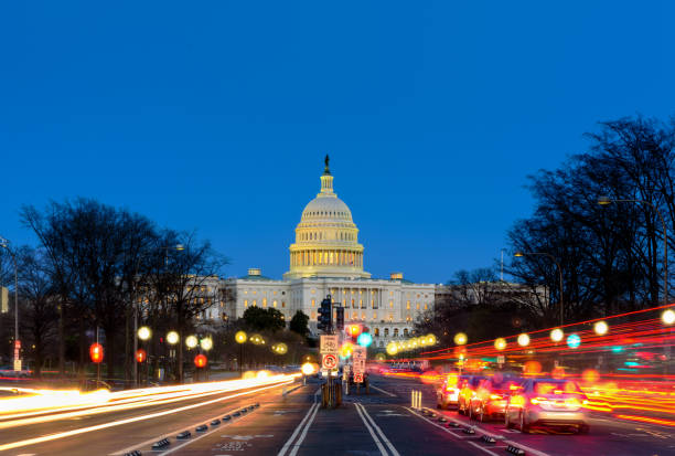 Capitol Building at  Sunset Pennsylvania Ave, Washington DC Capitol Building at  Sunset Pennsylvania Ave, Washington DC capitol building washington dc stock pictures, royalty-free photos & images