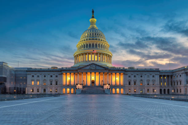 US Capitol building at sunset stock photo