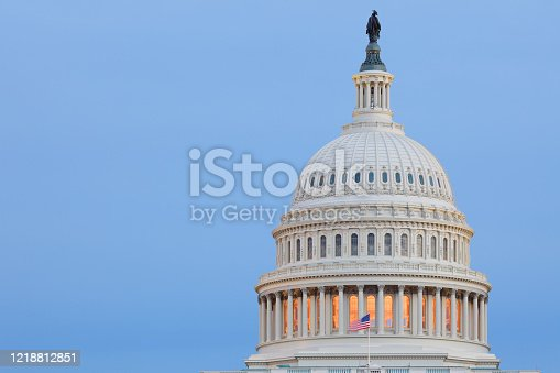 Telephoto view of the dome of the United States Capitol building at twilight. A neoclassical structure in Washington DC (c. 1800) - the US Capitol is located on at the eastern end of the National Mall. It is the the home of the US house of representatives and the US senate.