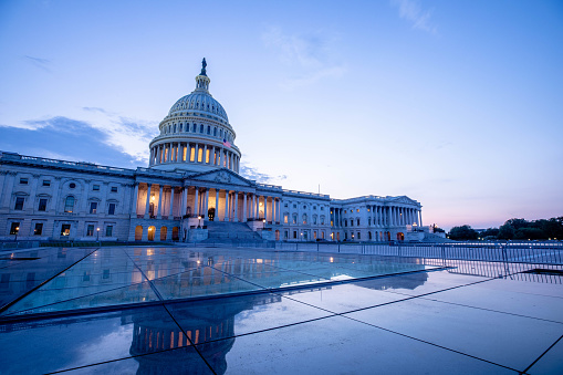 The US Capitol Building at dusk.