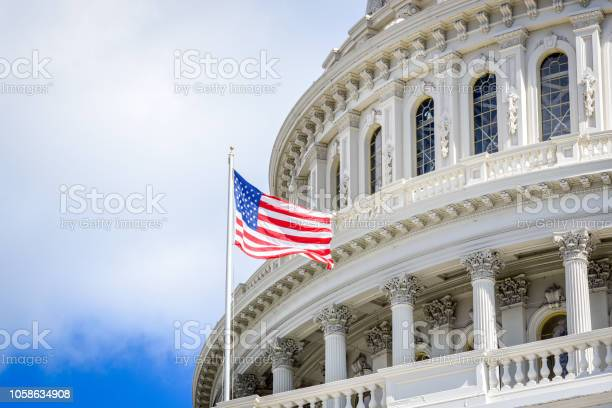 Capitol building in washington dc with usa flag picture id1058634908?b=1&k=6&m=1058634908&s=612x612&h=oeesumimgnckxhi8nztezhluc88bsvo3cq7drio1 w4=