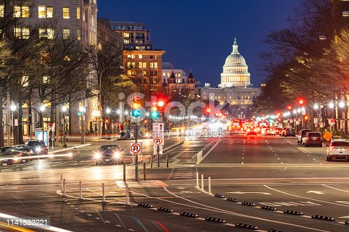 US Capitol Building at sunset along street in Washington, DC, USA