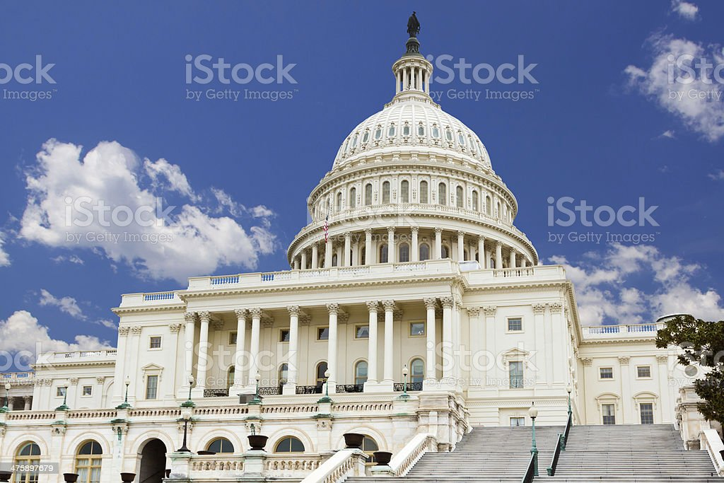 US Capitol Building, Washington DC. Clear blue sky, clouds. stock photo