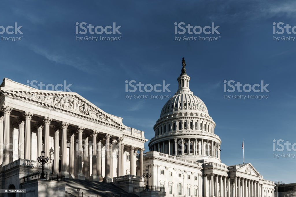 Capitol Building with blue sky from side view, Washington DC Capitol Building with blue sky from side view, Washington DC Architectural Column Stock Photo