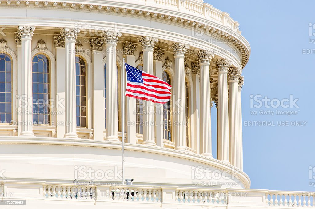 US Capitol Dome with American flag at full mast stock photo