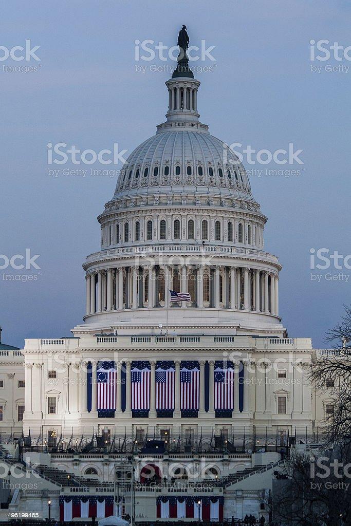 U.S. Capitol dome with Inauguration Flags stock photo