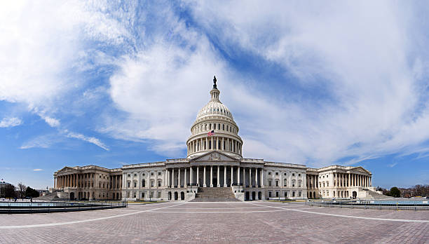 US Capitol - Government building Wide angle panorama of the US United States Capitol building for Democrat Republican Government Senate and House congress parties under a summer blue sky with white clouds. capitol hill stock pictures, royalty-free photos & images