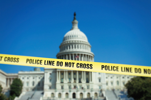 Capitol in Washington DC with police fence tape