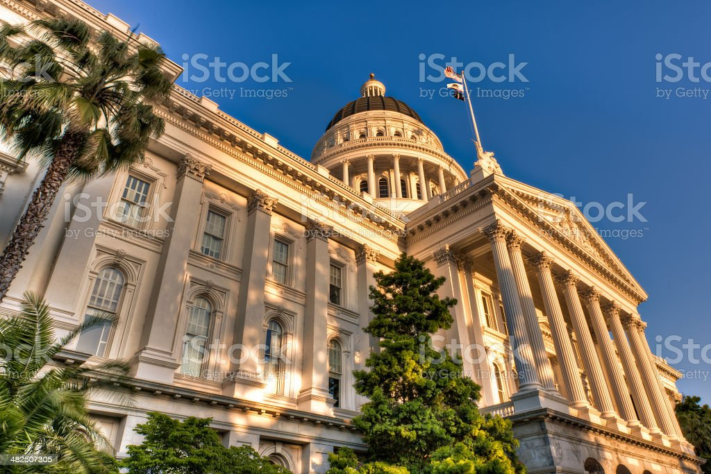 Capitol lit by setting sun stock photo