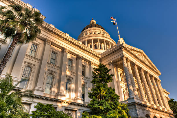 Capitol lit by setting sun California State Capitol building in the warm light of the setting sun. state capitol building stock pictures, royalty-free photos & images