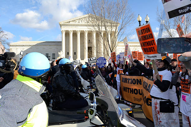 U.S. Capitol Police Confront Protesters At U.S. Supreme Court Washington D.C., USA - January 22, 2015; U.S. Capitol Police confront Pro-Choice protesters at the U.S. Supreme Court. pro choice stock pictures, royalty-free photos & images