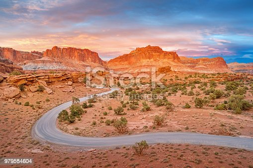 Stock photograph of a winding dirt road in Capitol Reef National Park Utah USA during sunset
