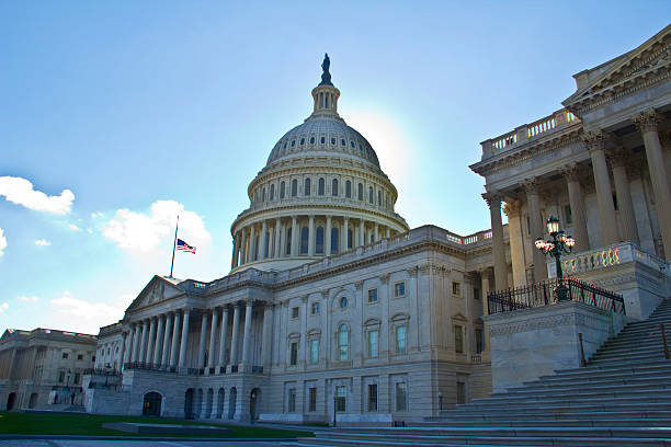 Capitol with flag at half-mast stock photo