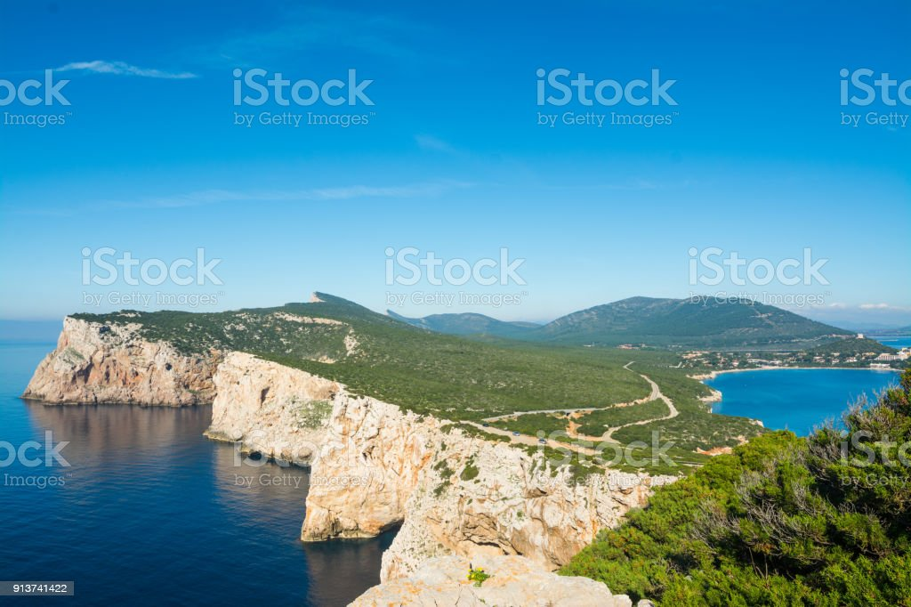 Capo Caccia under a blue sky stock photo