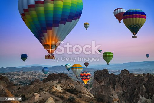Sunrise in Cappadocia, about hundreds of colorful balloons rising into the sky. Wonderful view.