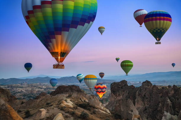 Cappadocia Balloon Tour Sunrise in Cappadocia, about hundreds of colorful balloons rising into the sky. Wonderful view. anatolia stock pictures, royalty-free photos & images