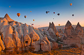 Hot Air Balloons rise up over the Goreme Valley in Cappadocia, Turkey